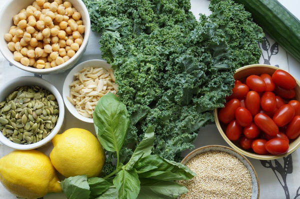 kale salad ingredients on board
