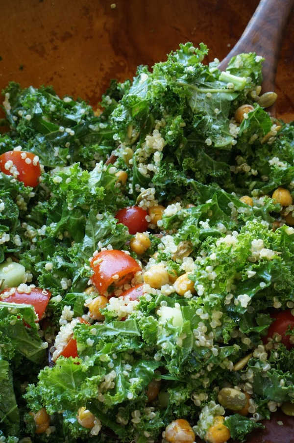 kale salad with crispy chick peas tossed in bowl