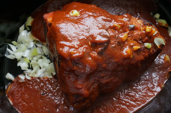pulled pork with sauce in the slow cooker