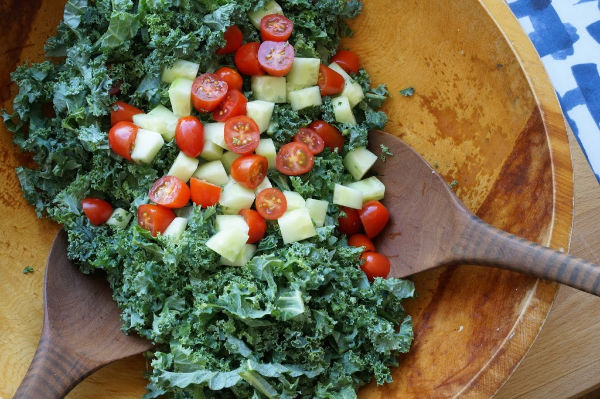 kale, tomatoes and cucumbers in big salad bowl