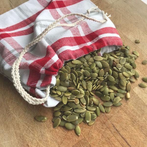 drawstring bag with pumpkin seeds
