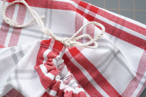 drawstring bag from a tea towel with string knotted