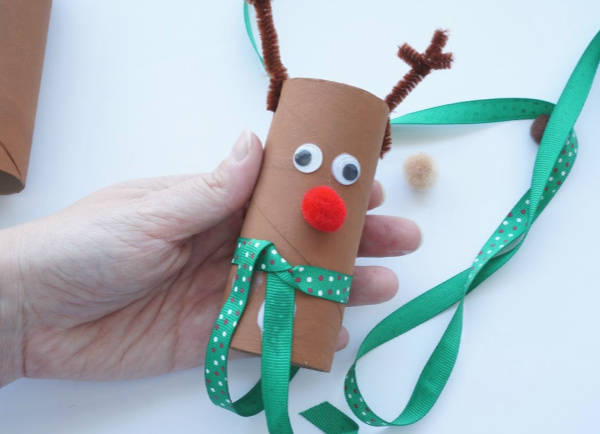 toilet paper rudolph with scarf wrapped on and glued
