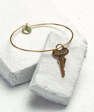 giving key bracelet with key on the bracelet