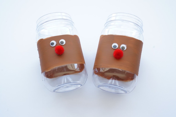 stripe of brown paint with reindeer face on jar