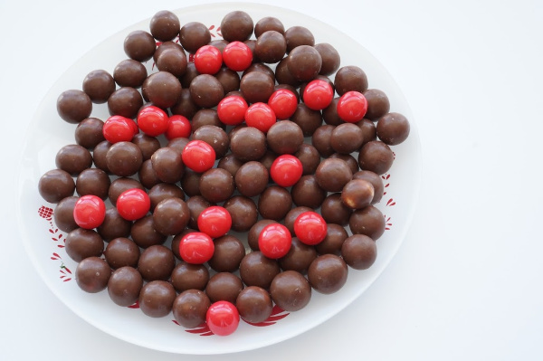 chocolate malt balls and red pom poms