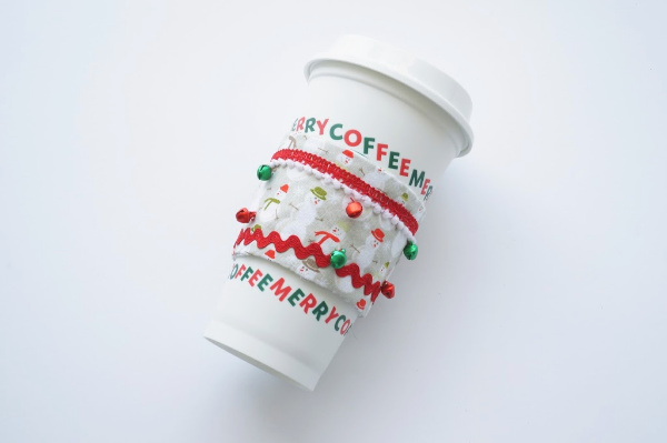 Christmas coffee cup sleeve on coffee cup