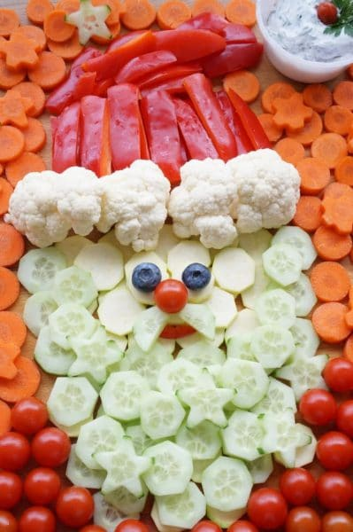 santa veggie tray with carrot background and cherry tomato shirt