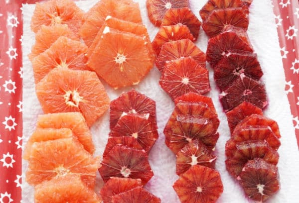 blood orange slices on paper towel lined tray