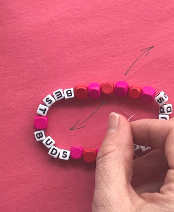 tying knot in stretch thread bracelet