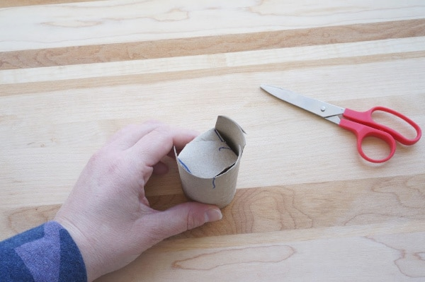 folding the bottom of the toilet paper roll pot