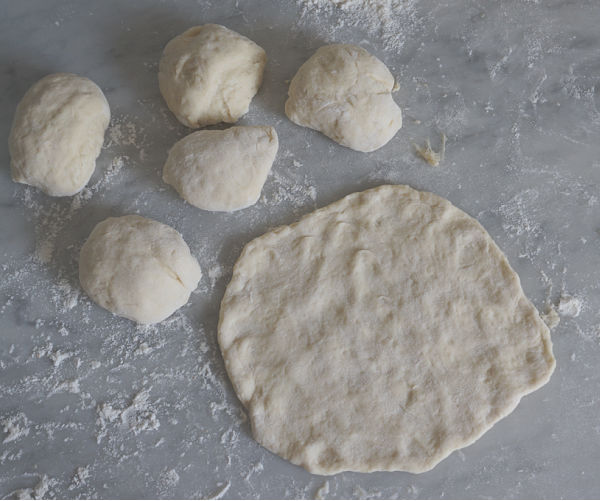 calzone dough recipe divided into 6 pieces
