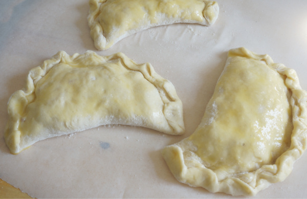 nectarine calzones on parchment paper