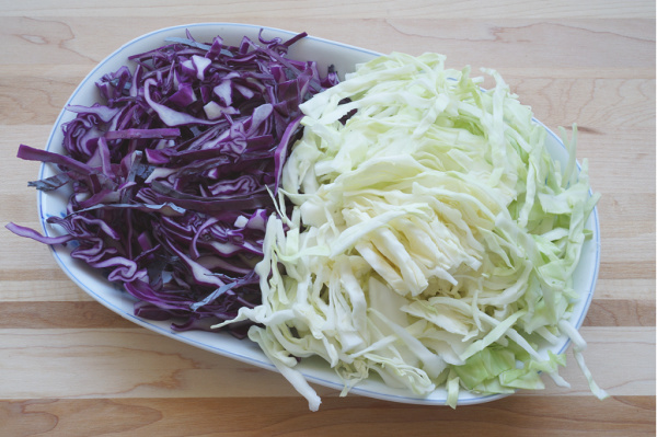 thinly sliced purple and green cabbage on plate