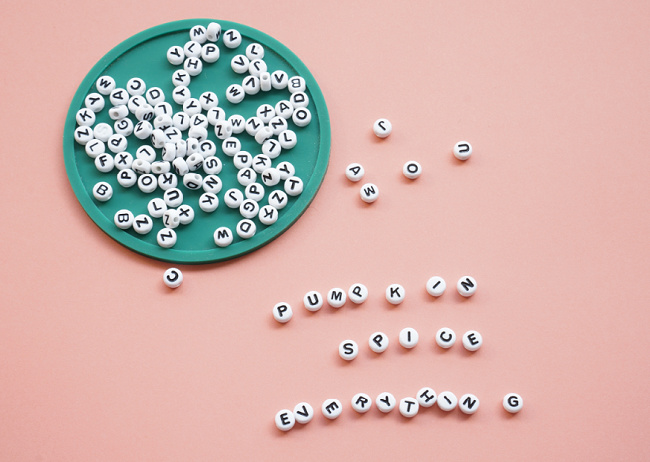 alphabet letter beads on table