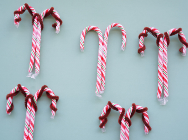 reindeer candy canes with pipe cleaner antlers and taped together