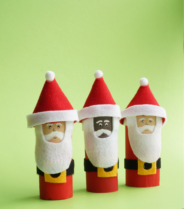 3 toilet paper roll santas all lined up one Black santa and two caucasian santas