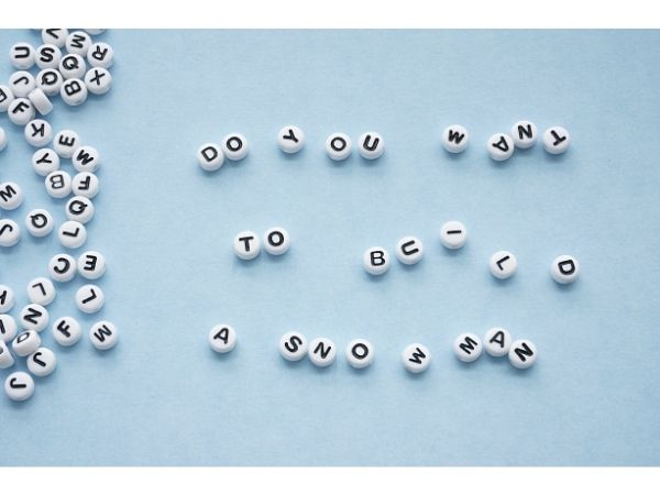 do you want to build a snowman letter beads on table