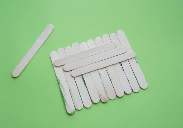 craft sticks glued together side by side