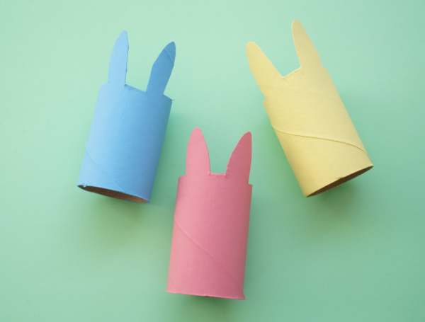 three paper roll bunny painted pink blue and yellow