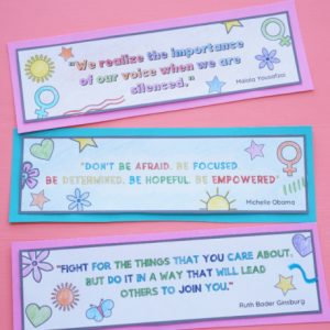 three women's quotation bookmarks coloured in and cut out on table