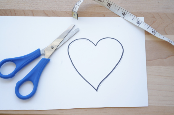 heart drawn on paper with scissors and tape measure