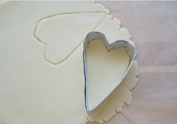 diy heart cookie cutter pressed into cookie dough