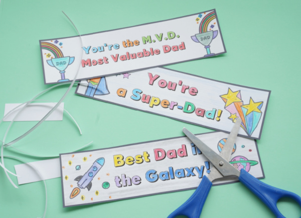 printable fathers day bookmarks cut out with scissors on table