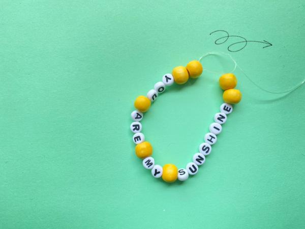 surgeons knot in summer bracelet