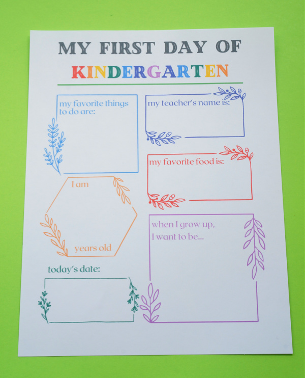 first day of kindergarten printable sign printed out on paper