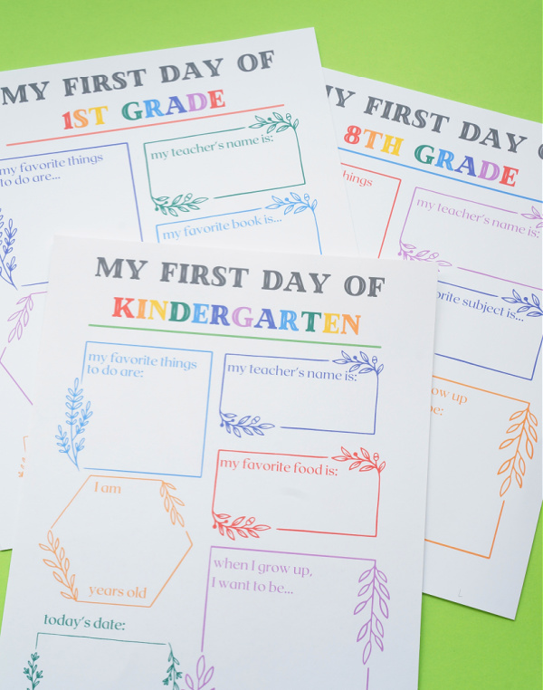 pile of first day of school printable signs