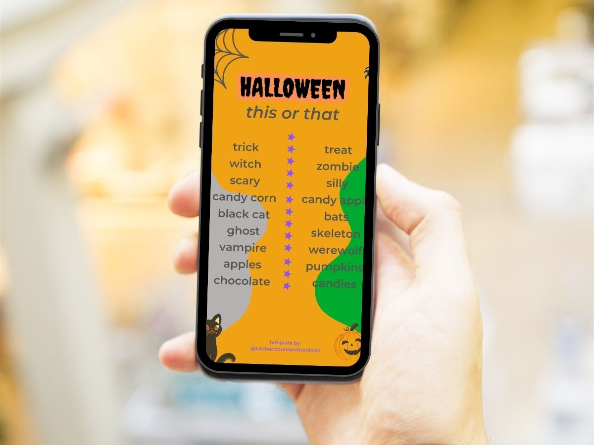 halloween this or that instagram story template on cell phone in person's hand