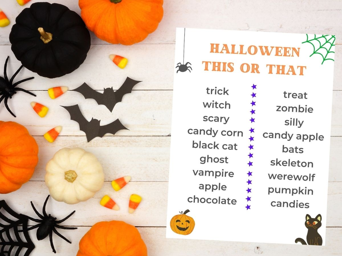 halloween this or that printable on table with pumpkins and candy corn bats and spiders