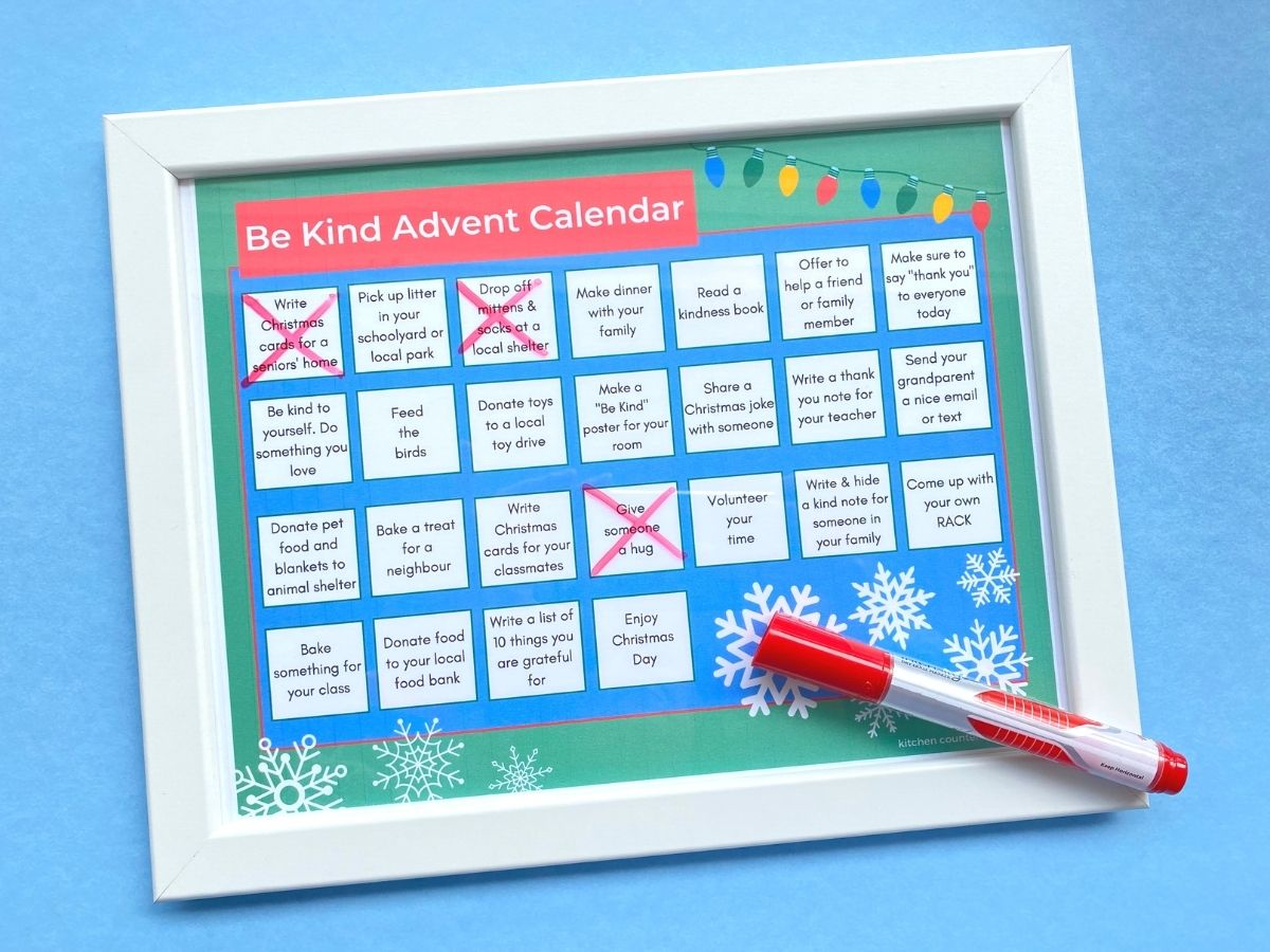 be kind advent calendar in frame with white board marker