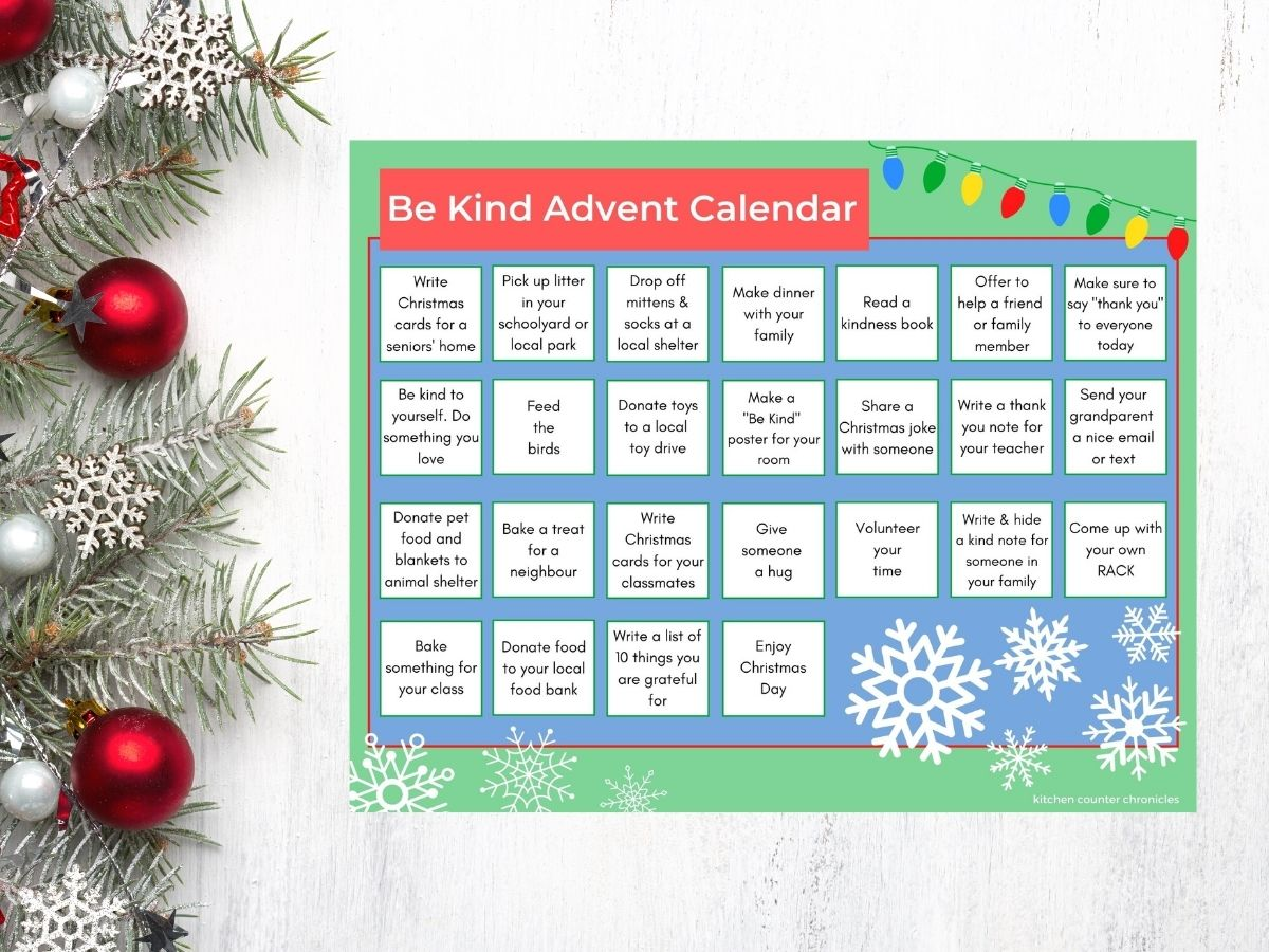 kindness advent calendar printed out on table with pine branches